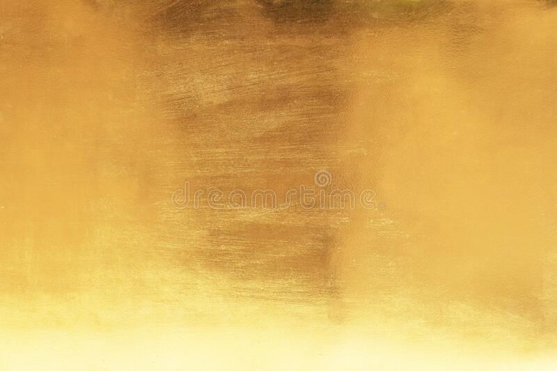 Gold abstract background or texture smooth and gradients shadow. Soft focus.  royalty free stock photo