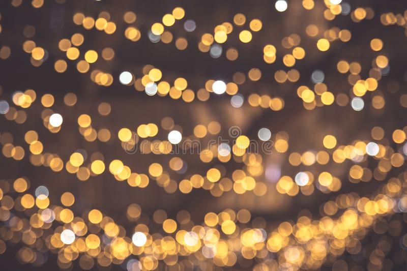 Gold abstract bokeh background. Christmas gold background. Golden holiday glowing backdrop royalty free stock image