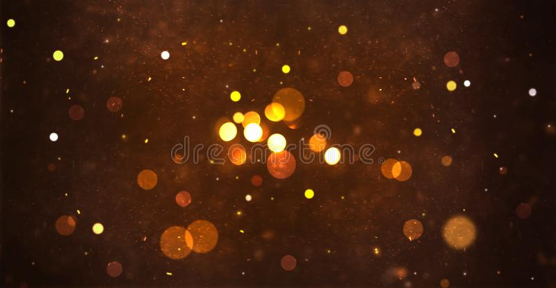 Gold abstract particle and bokeh for background stock images