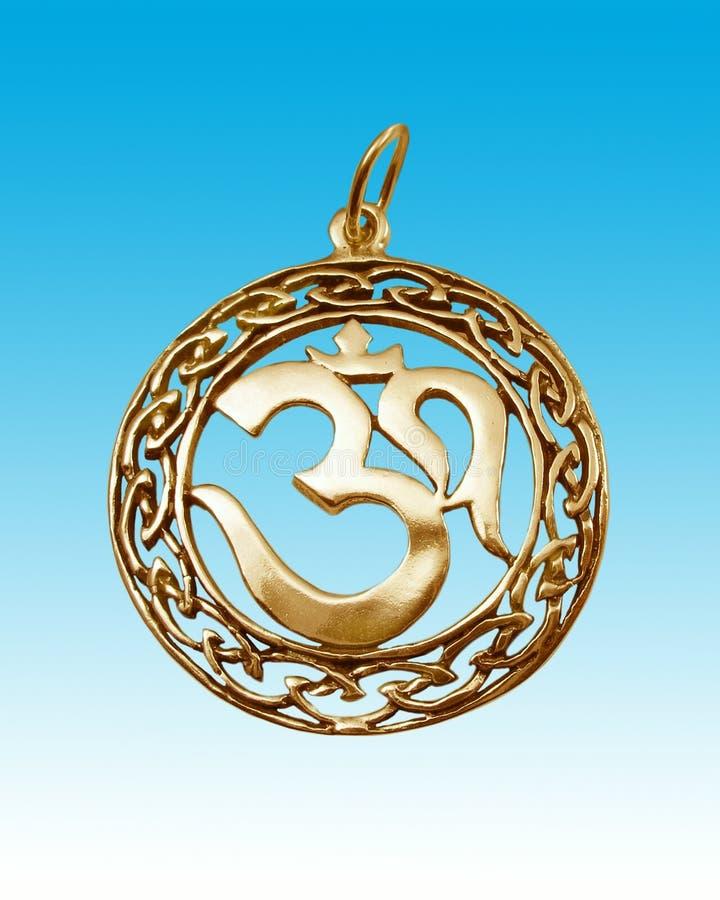 Gold amulet on heavens background. royalty free stock image