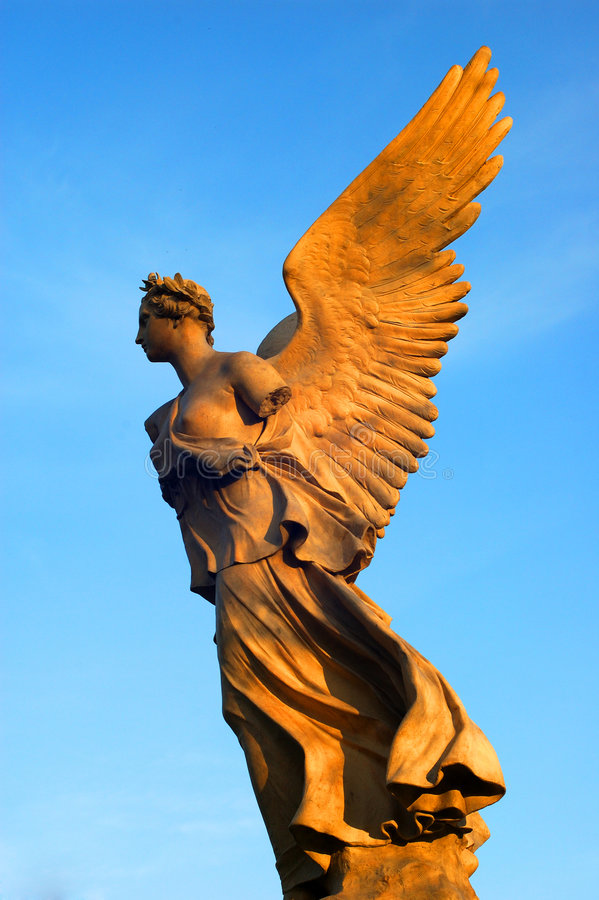 Gold angel. The sculpture of gold angel from garden royalty free stock images