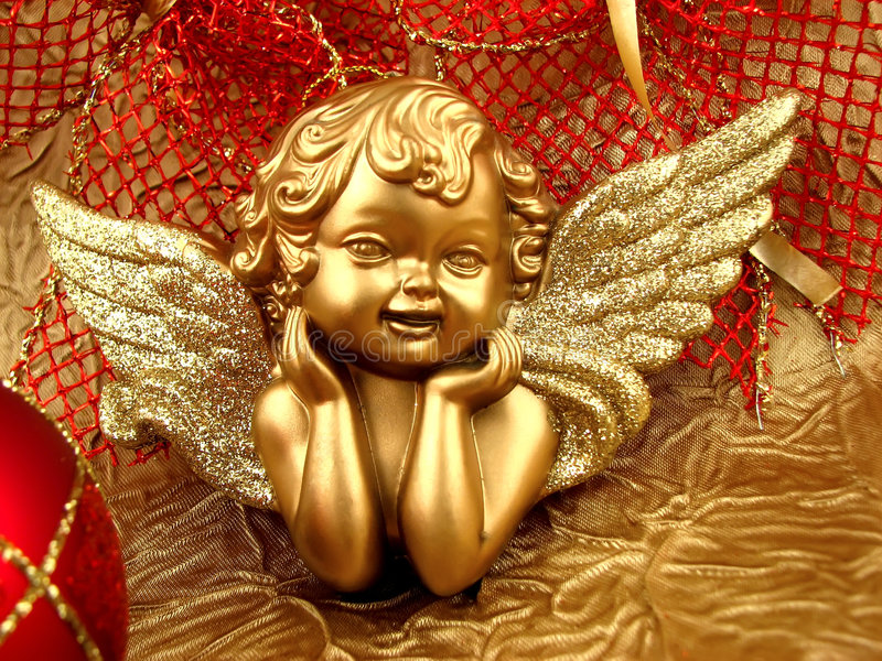 Gold Angel. With red ribbon on background royalty free stock photos