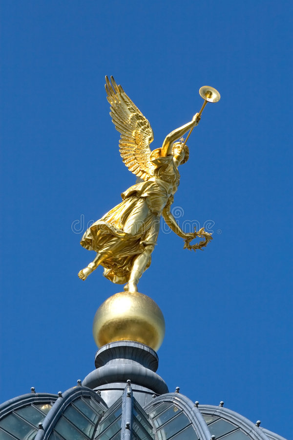 Gold angel on the blue sky. Gold angel on the University building (Dresden, Germany royalty free stock photography