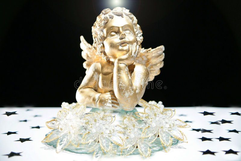 Gold angel with halo. Feeling the christmas spirit royalty free stock photography