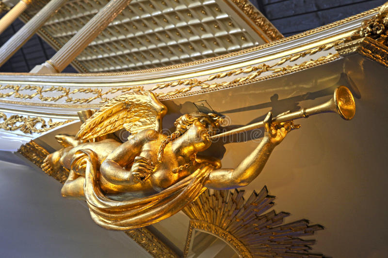 Gold angel statue on baroque ship. Gold angel statue on bowsprit of baroque dutch medieval ship detail, selective focus stock photos