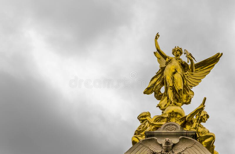 Gold Angel Statue Under Grey Clouds royalty free stock photography