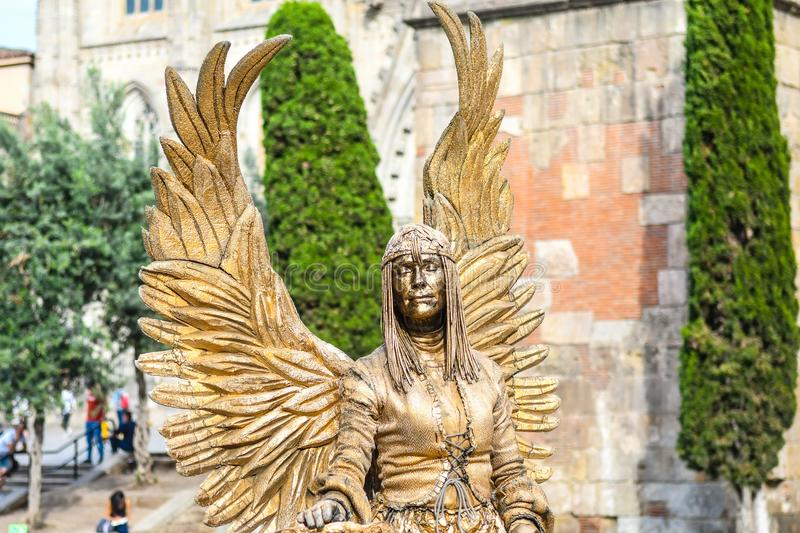Gold Angel. A woman dressed in a gold angel costume in Barcelona Spain stock photo