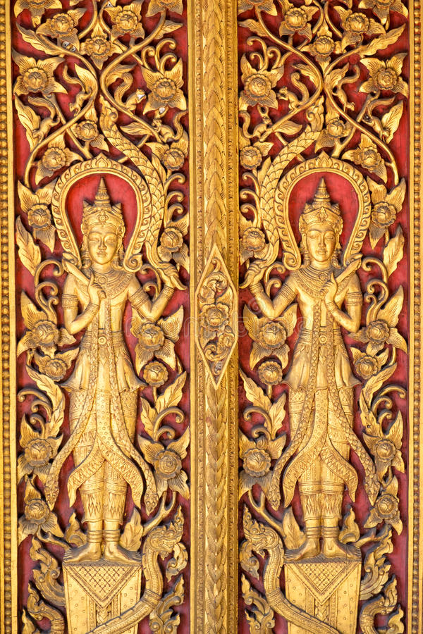 Gold Angels stripes Thai arts on door church. Gold stripes Thai arts on door church at public temple stock photos