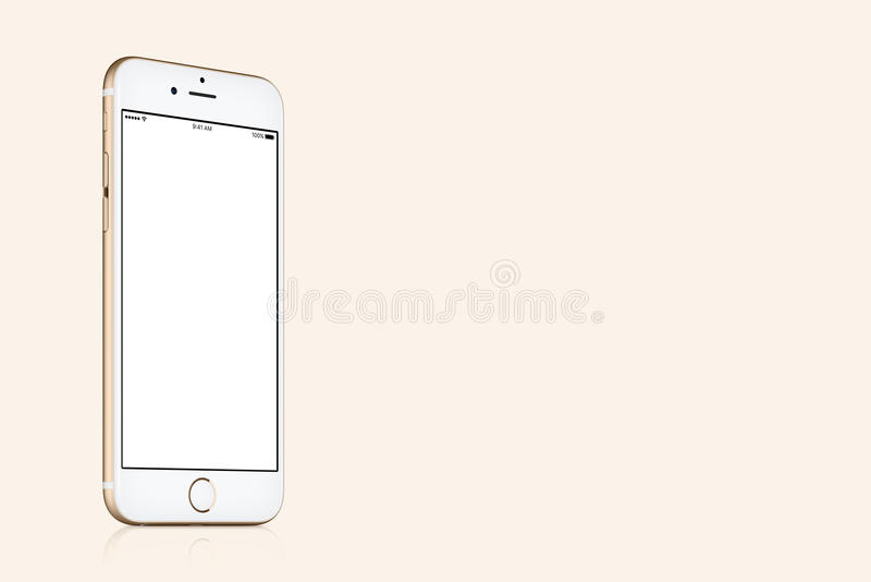 Gold Apple iPhone 7 mockup on solid gold background with copy space stock photography