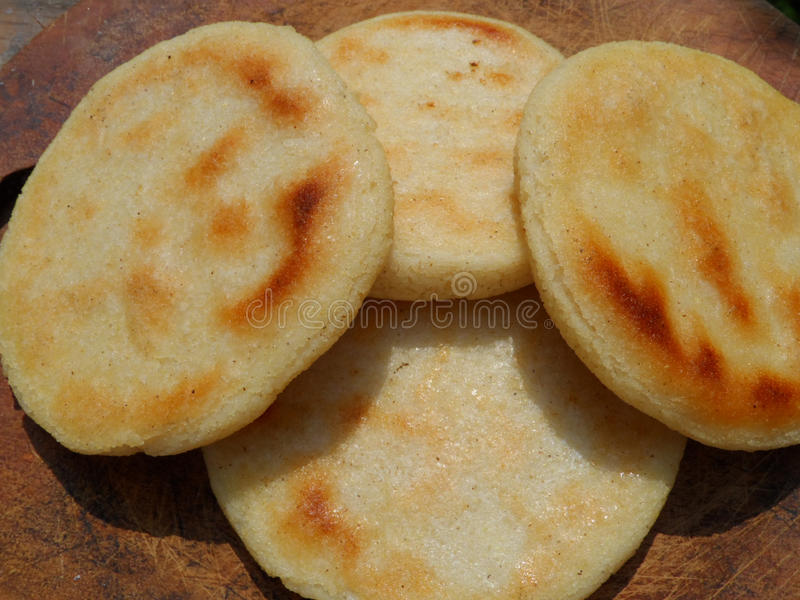 Gold arepas royalty free stock photography