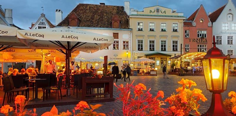 Gold Autumn Rainy evening people umbrellas street cafe city light lamp old town of Tallinn ,Estonia,02,09,2019  cityscape travel t. O  holiday dinner hotel in stock photos
