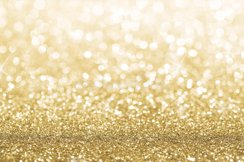 Gold background. Gold defocused glitter background with copy space