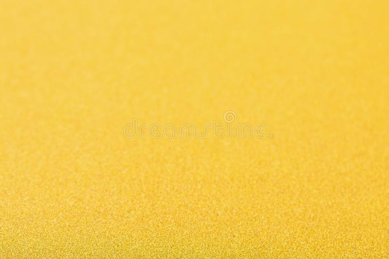 Gold background, abstract Christmas glitter bokeh blank for design.  royalty free stock image