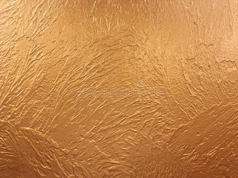 Gold background paper, texture is old vintage distressed solid glitter gold color with rough peeling grunge paint on edges. royalty free stock image