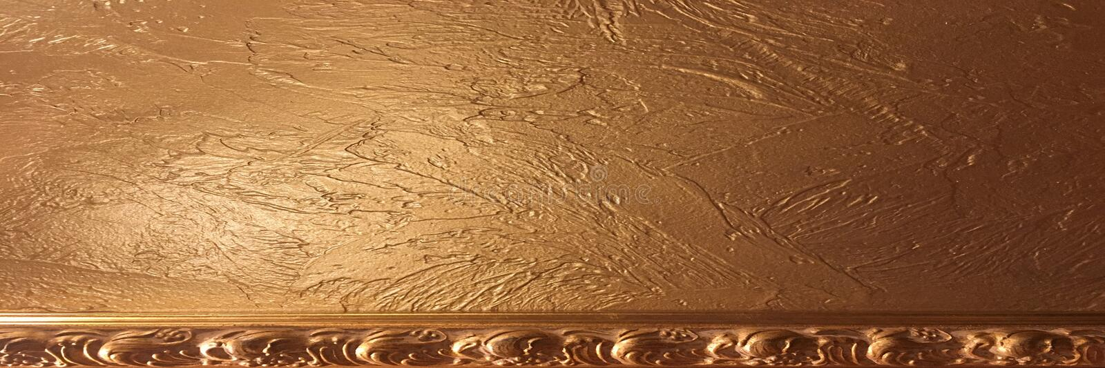 Gold background paper, texture is old vintage distressed solid glitter gold color with rough peeling grunge paint on edges. Gold background paper, texture is stock image