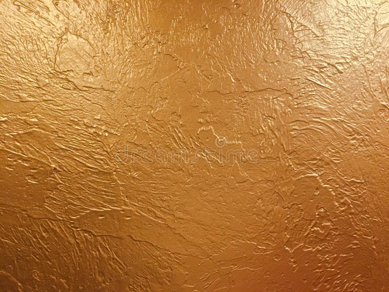 Gold background paper, texture is old vintage distressed solid glitter gold color with rough peeling grunge paint on edges. stock photos