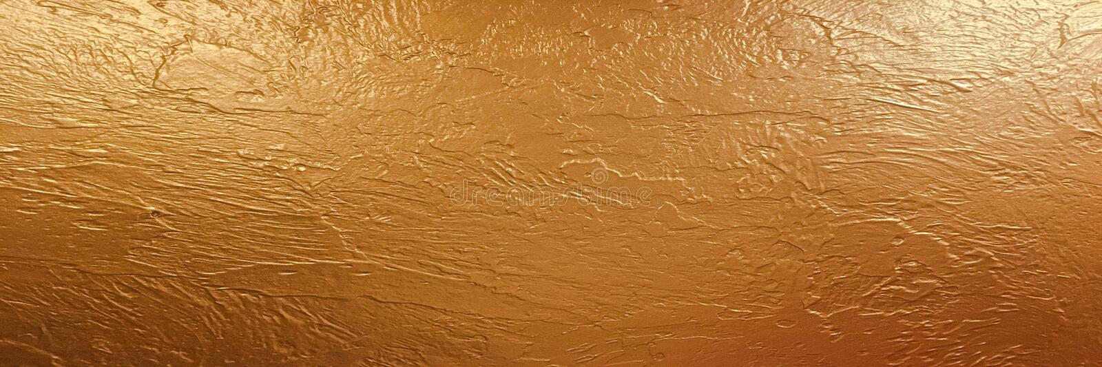 Gold background paper, texture is old vintage distressed solid glitter gold color with rough peeling grunge paint on edges. stock image