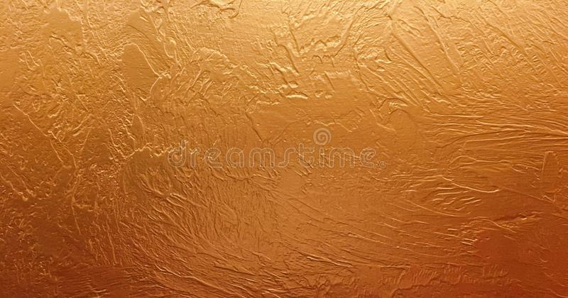 Gold background paper, texture is old vintage distressed solid gold color with rough peeling grunge paint on edges. royalty free stock photo