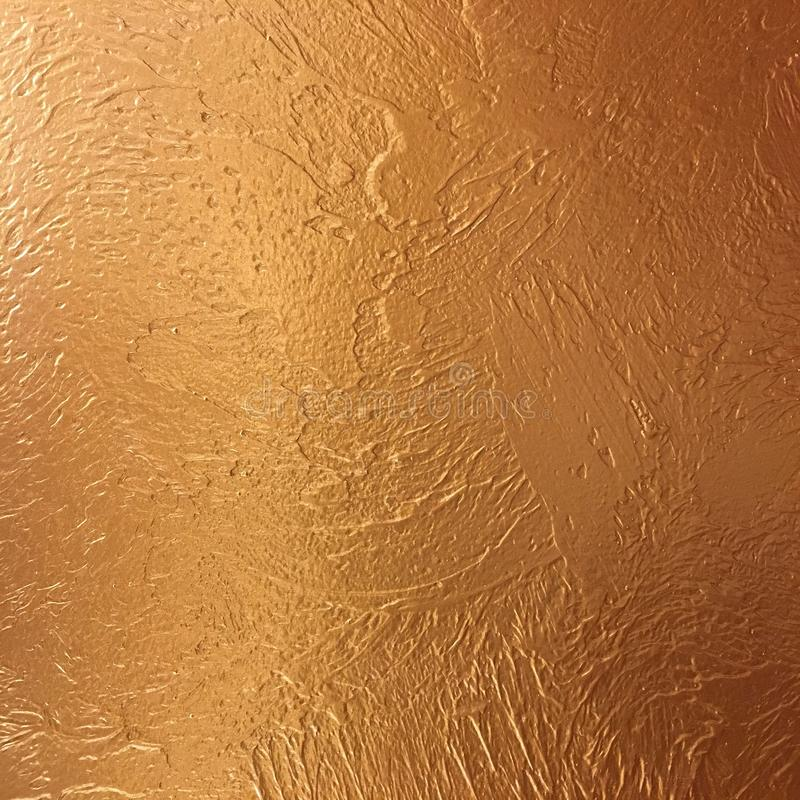 Gold background paper, texture is old vintage distressed solid gold color with rough peeling grunge paint on edges. Gold background paper, texture is old stock photos