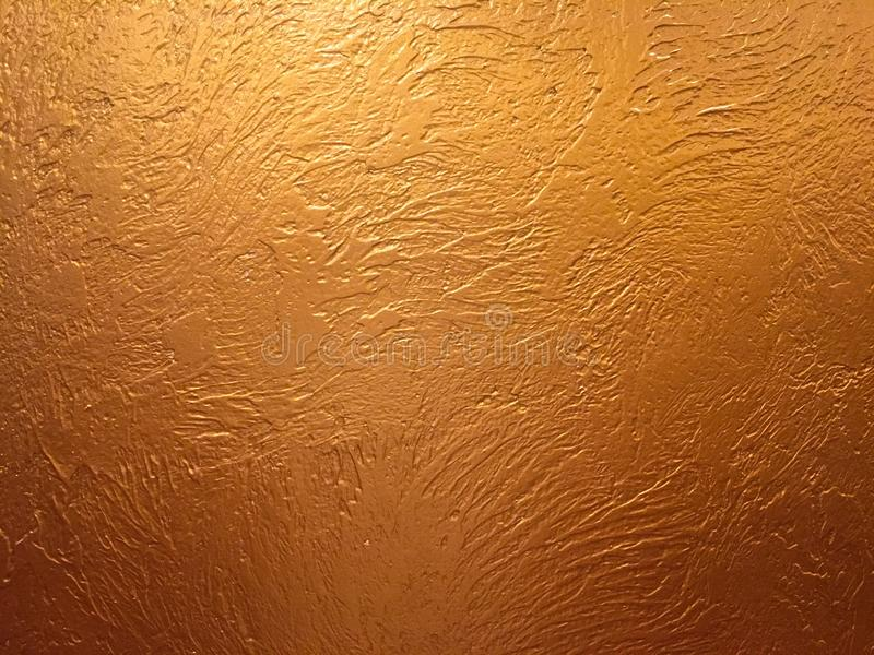 Gold background or texture and gradients shadow. Gold background paper, texture is old vintage distressed solid glitter gold color. With rough peeling grunge royalty free stock image