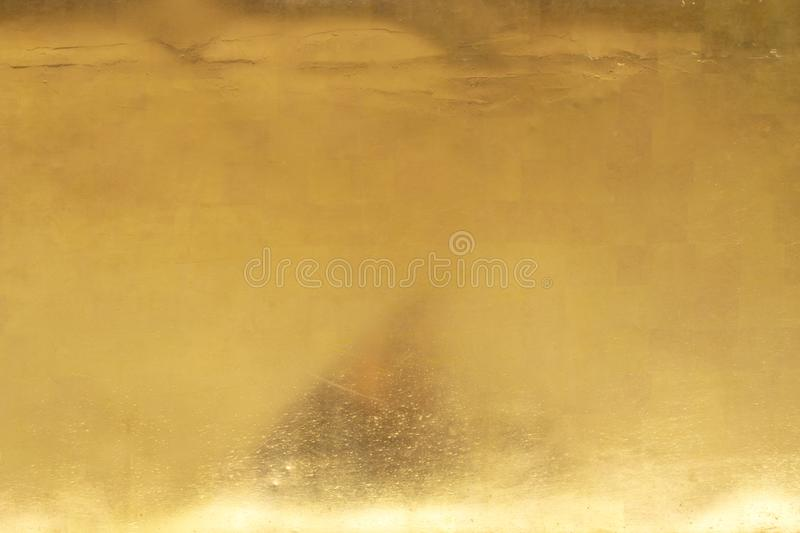 Gold background or texture and gradients shadow.  royalty free stock photo
