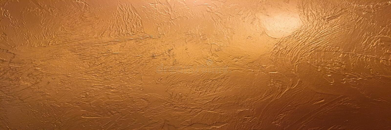 Gold background or texture and gradients shadow. Shiny yellow leaf gold foil texture background. Gold background paper, texture is stock photo
