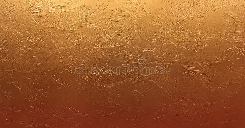 Gold background or texture and gradients shadow. Shiny yellow leaf gold foil texture background. royalty free stock photos