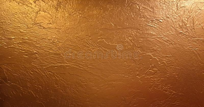 Gold background or texture and gradients shadow. Shiny yellow leaf gold foil texture background. stock photo