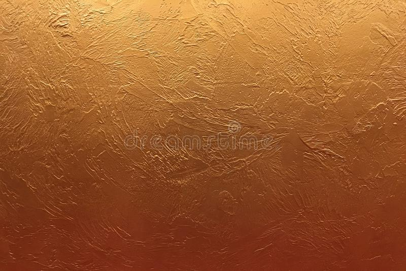 Gold background or texture and gradients shadow. Shiny yellow leaf gold foil texture background. royalty free stock photo