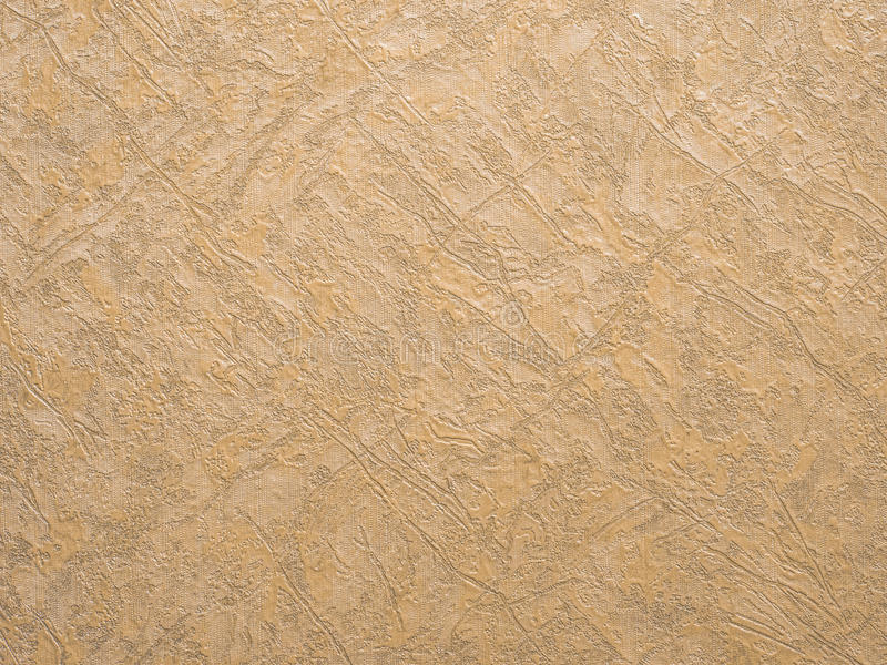 Gold background texture. Wallpaper on the wall stock image