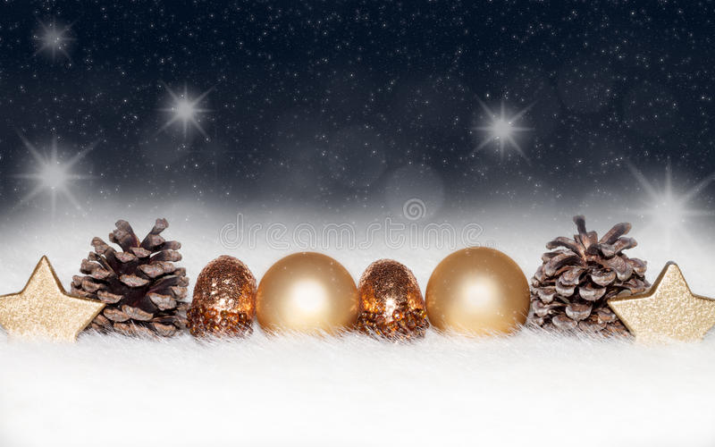 Gold balls, baubles on blue Christmas background. Gold balls, baubles,decorations, ornaments on a blue Christmas background with blurry, blurred, lights (bokeh royalty free stock images