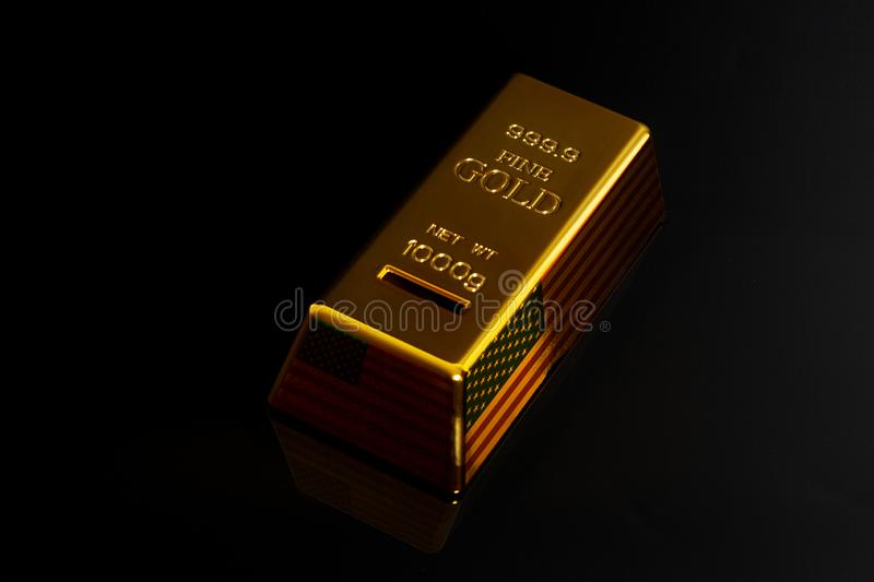 Gold bar with USA flag stock image