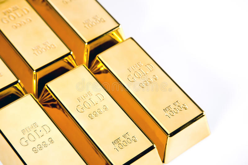 Gold bars closeup top view on white background royalty free stock photography