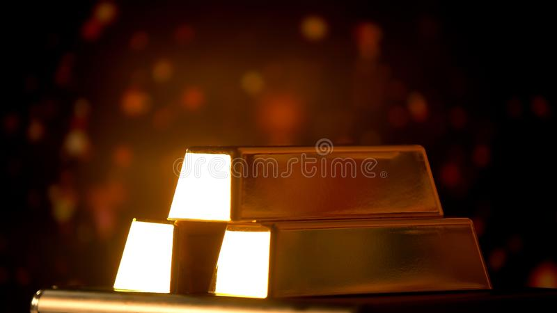 Gold bars on shiny background, financial investment and capital, pyramid scheme royalty free stock photos