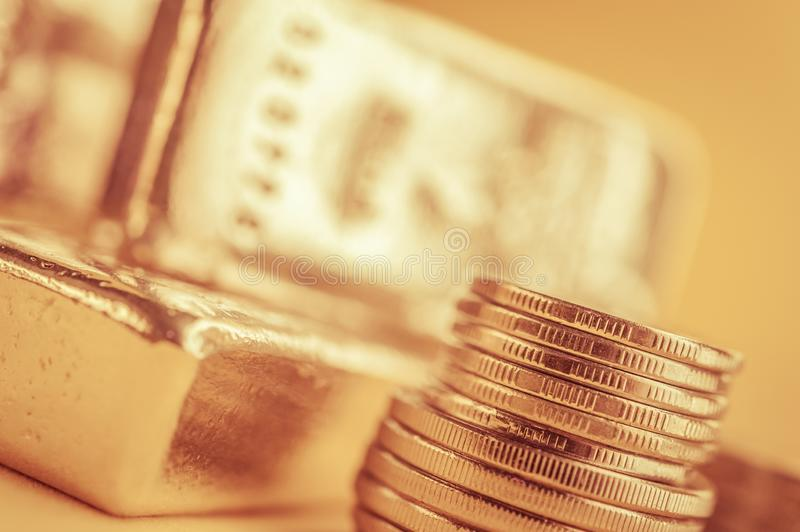 Gold bars and stack of gold coins. Background for finance banking concept. Trade in precious metals. Gold bars and stack of gold coins macro. Rows of coins and stock image