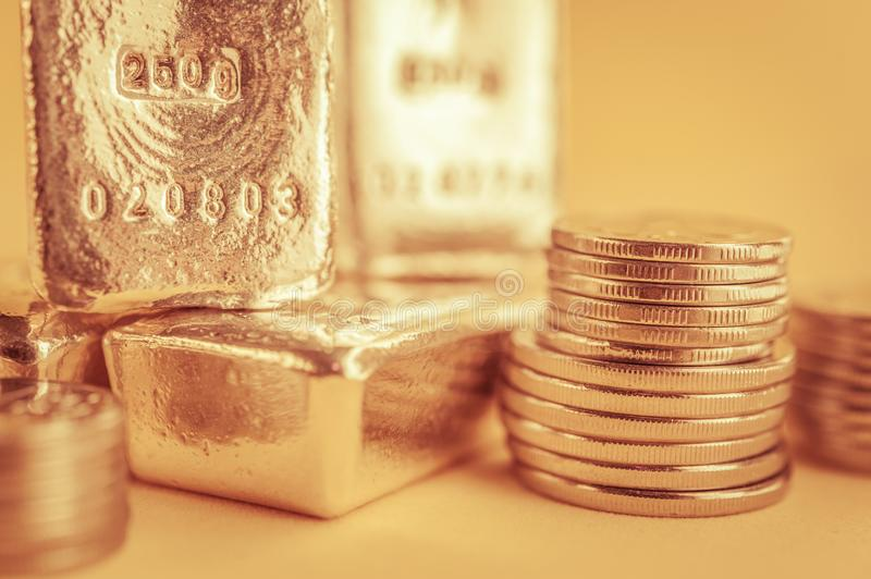 Gold bars and stack of gold coins. Background for finance banking concept. Trade in precious metals. Gold bars and stack of gold coins macro. Rows of coins and stock photo