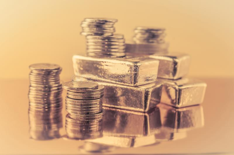Gold bars and stack of gold coins. Background for finance banking concept. Trade in precious metals. Gold bars and stack of gold coins macro. Rows of coins and stock images
