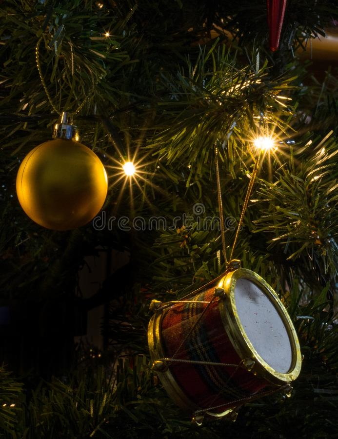Gold bauble. Hanging on Christmas tree royalty free stock photos