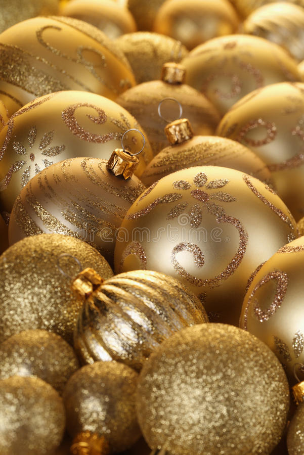 Gold Baubles. Close up of Gold Baubles of various sizes and designs royalty free stock photos