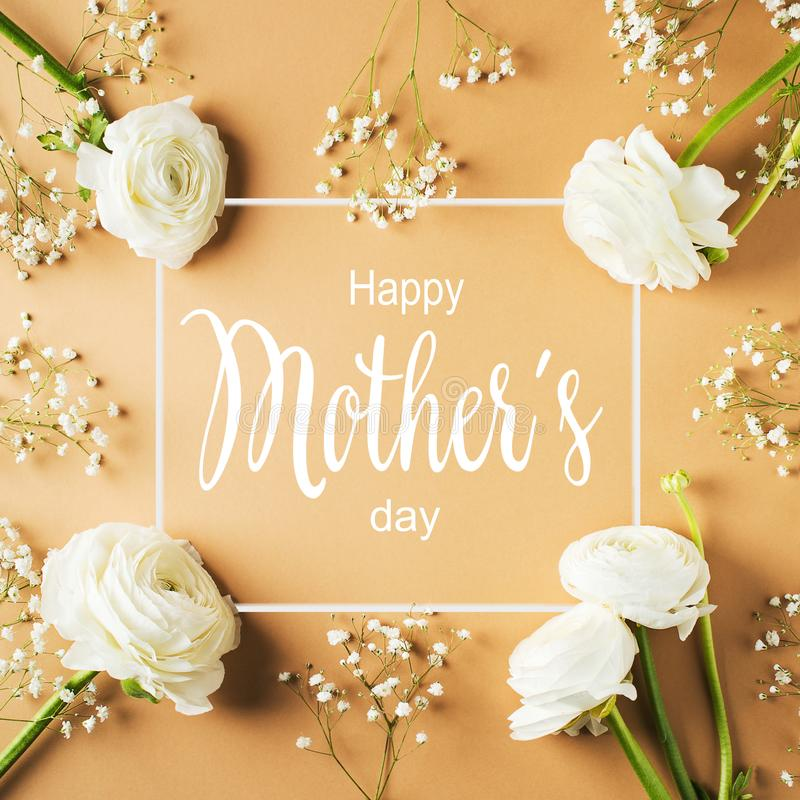 Gold, beige or yellow mothers day card flowers and gift flat lay with greeting text. Square stock images