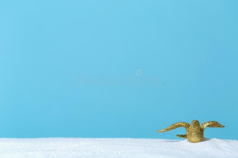Gold bird ornament. In a snow covered landscape stock photos