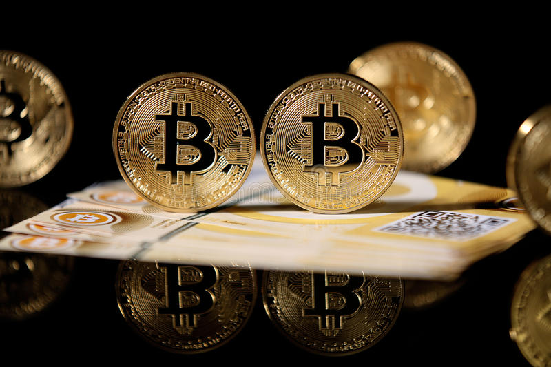 Gold Bitcoin and banknotes stock photo