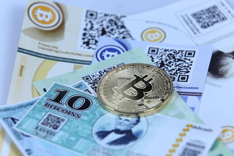 Gold Bitcoin and banknotes royalty free stock photos