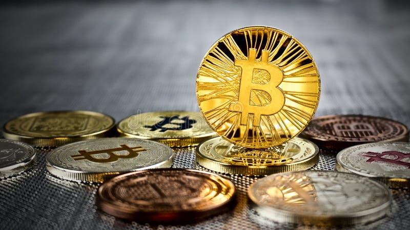 Gold bitcoin coin. Cryptocurrency physical gold bitcoin coin on bitcoins. Money concept