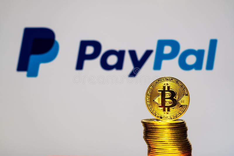 Gold Bitcoin coins with the PayPal logo on background screen. A new type of business finance concept royalty free stock images