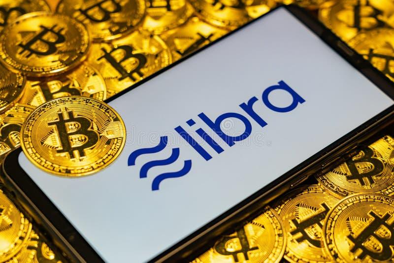 Gold Bitcoin Coins pile with the Facebook`s Libra Crypto Coin stock image