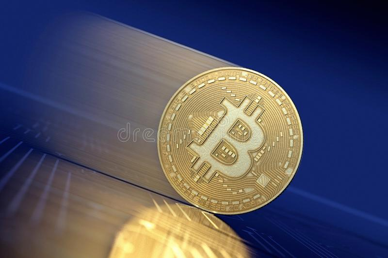 Gold Bitcoin moving down as in Bear Market. Bitcoin virtual money, golden physical version, moving down, as a symbol of value falling in a crypto Bear Market royalty free stock image