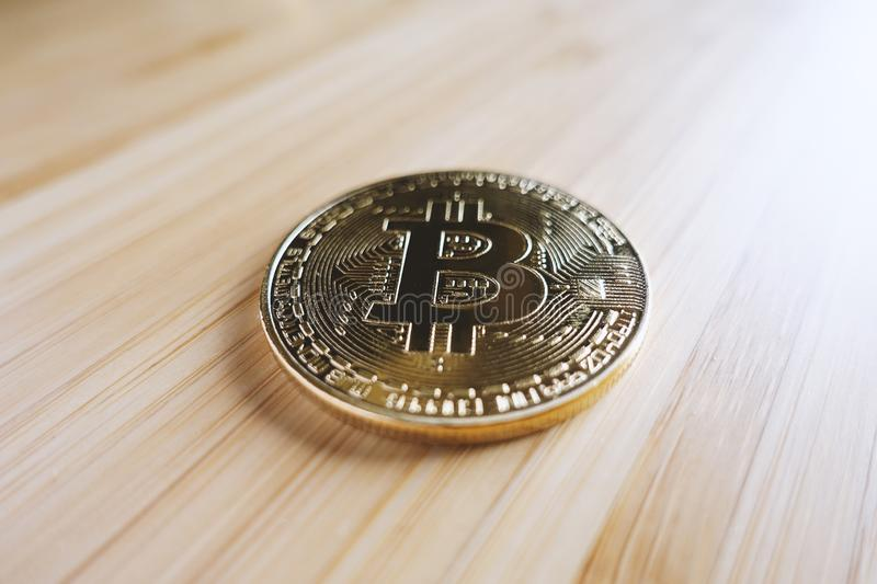 Gold bitcoin on the table stock photo