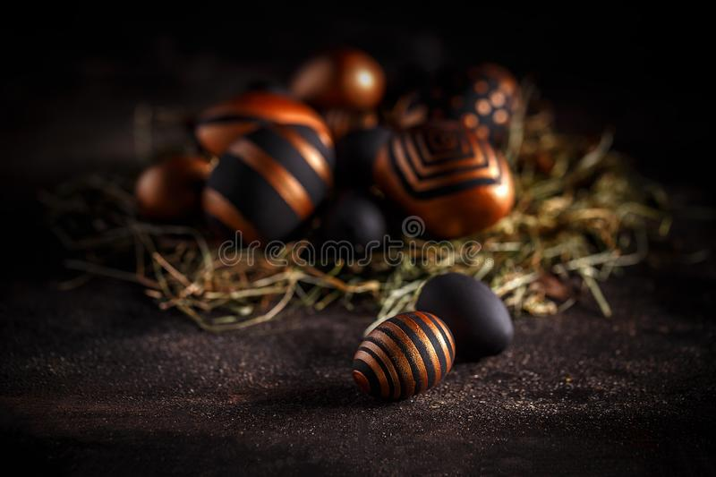 Gold and black Easter eggs stock photo