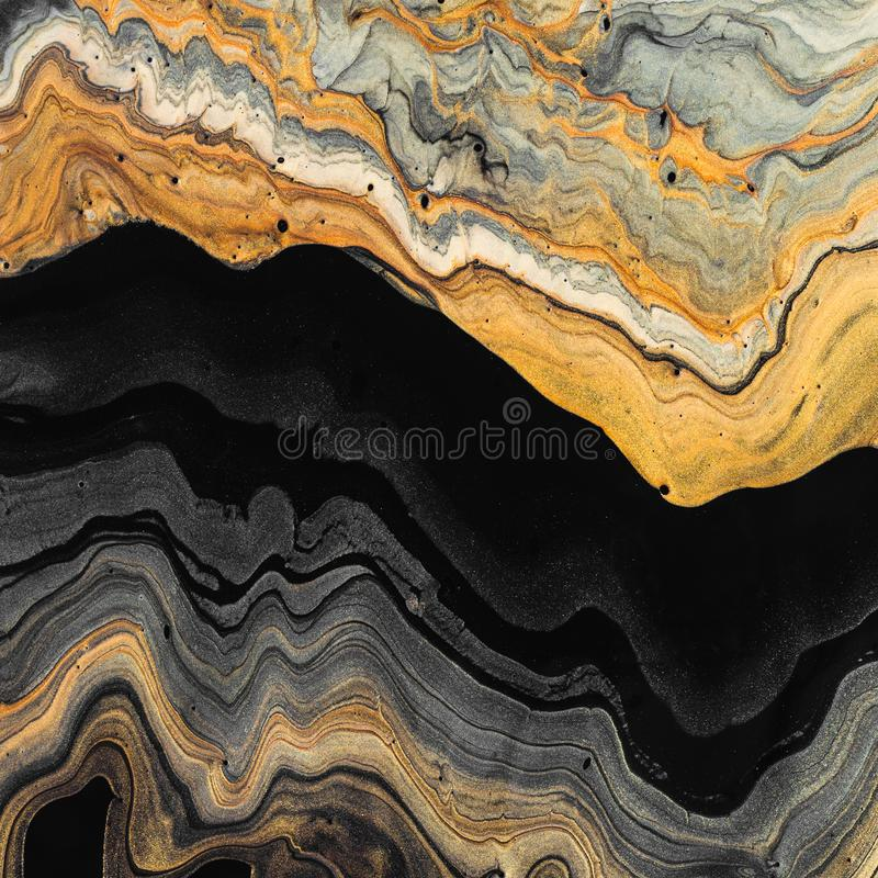 Gold and black waves. Abstract marble background or texture. Acrylic Fluid Art.  stock images